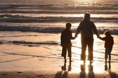 Single parent with kids on beach