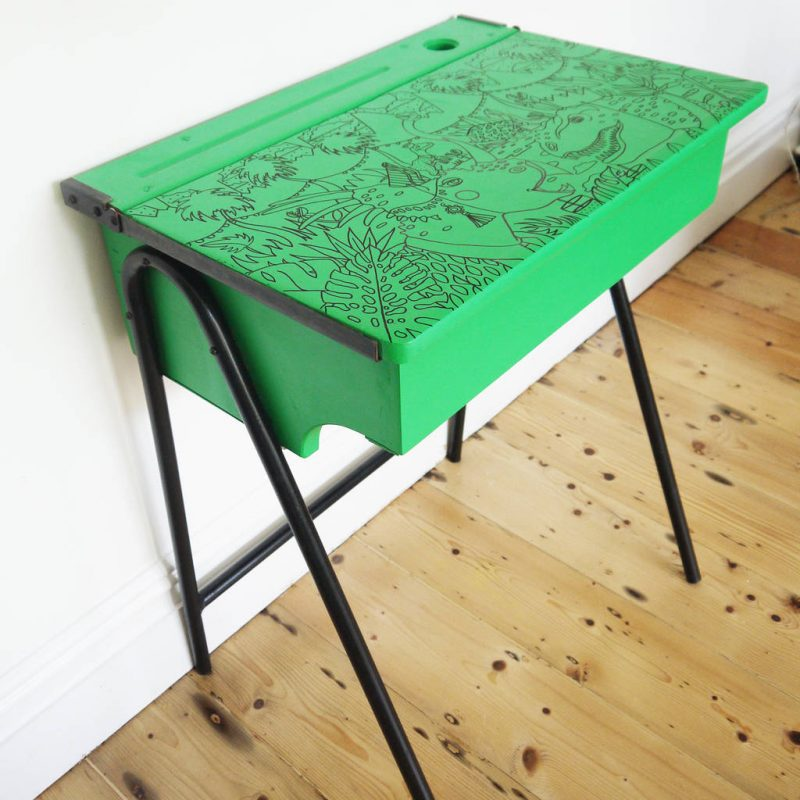 Green painted desk with dinosaur graphics