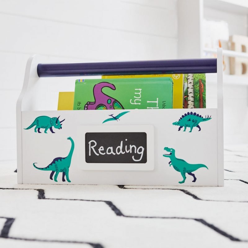 White carry caddy with dinosaur prints