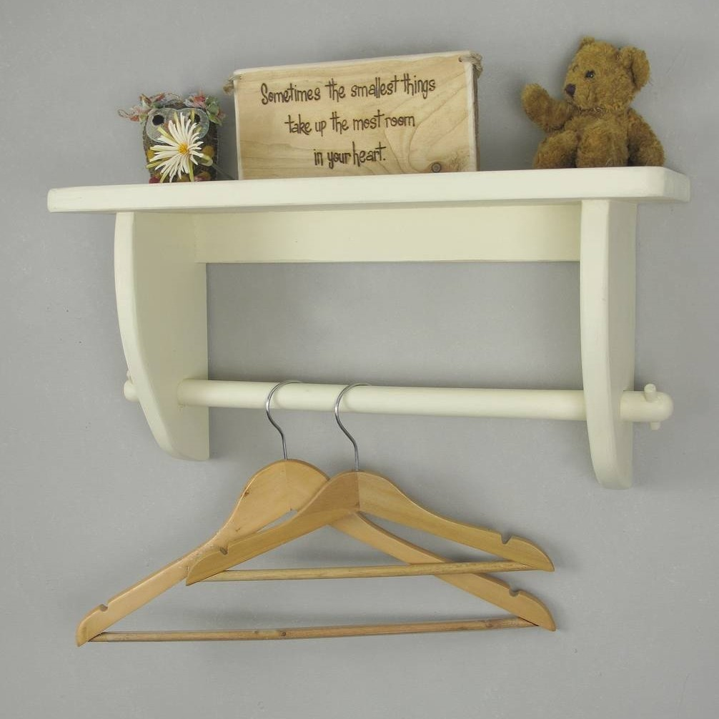 Cream painted shelf with a clothes rail