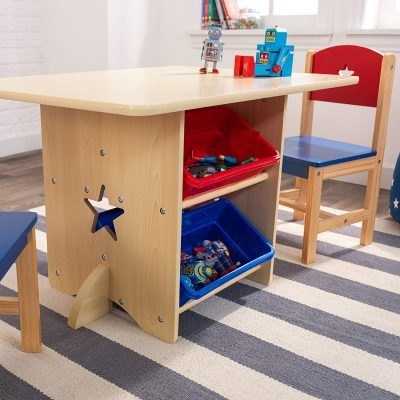 Kid's play table with red and blue storage bins