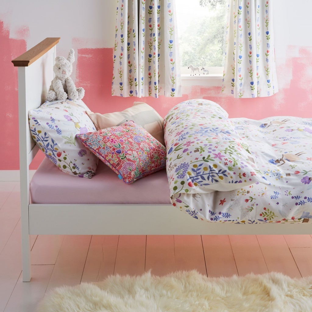 Floral print bedding with fairy motifs