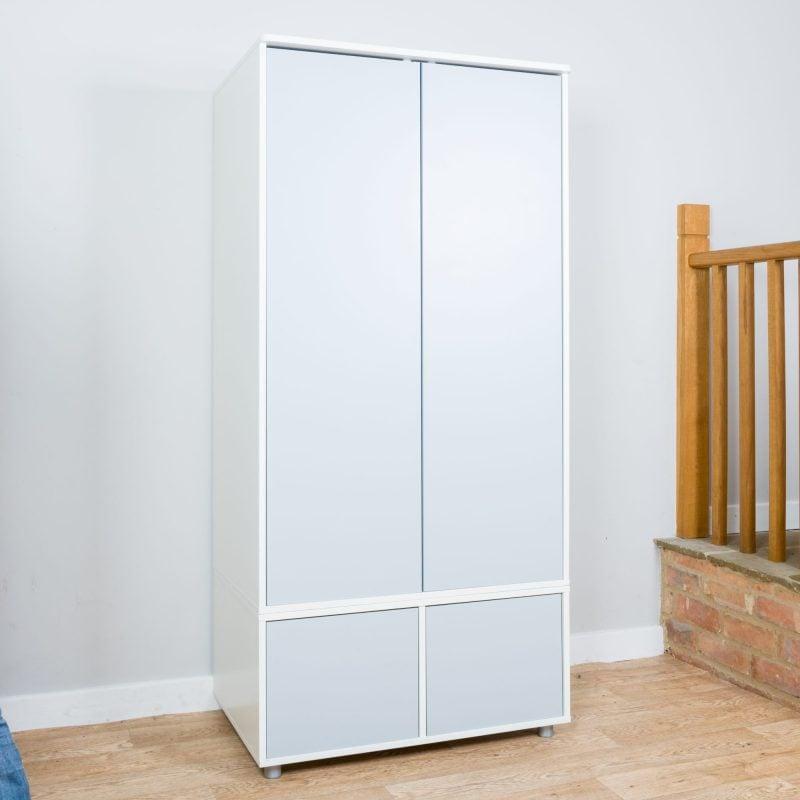 Wardrobe unit with storage drawer