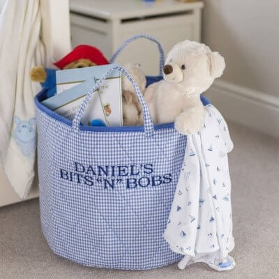 Toy storage hamper made from quilted blue gingham fabric