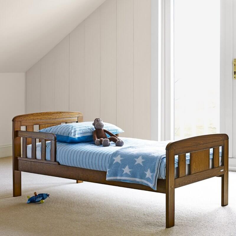 Dark stained pine toddler bed