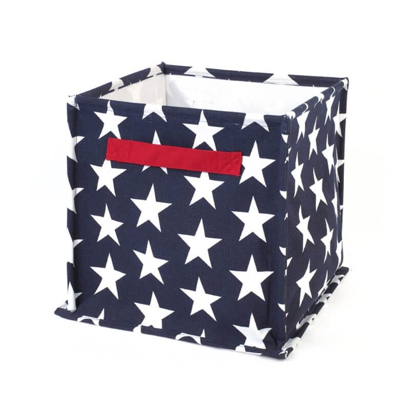 Blue canvas storage bin with white star pattern