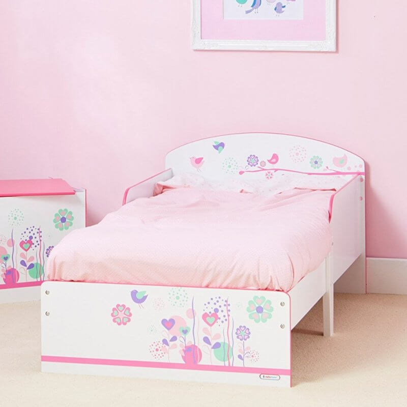 White frame toddler bed with floral graphics