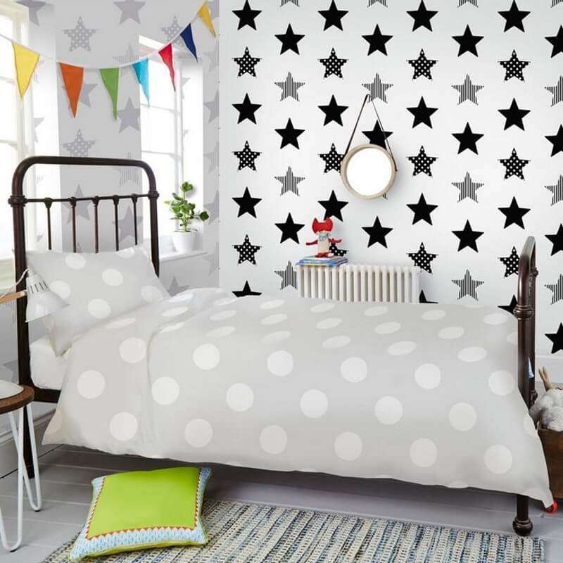 Kid's wallpaper with bold black and silver stars