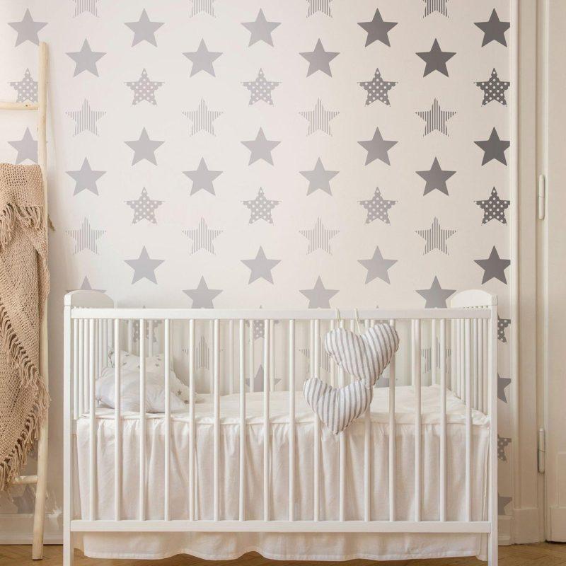 Silver stars on white wallpaper