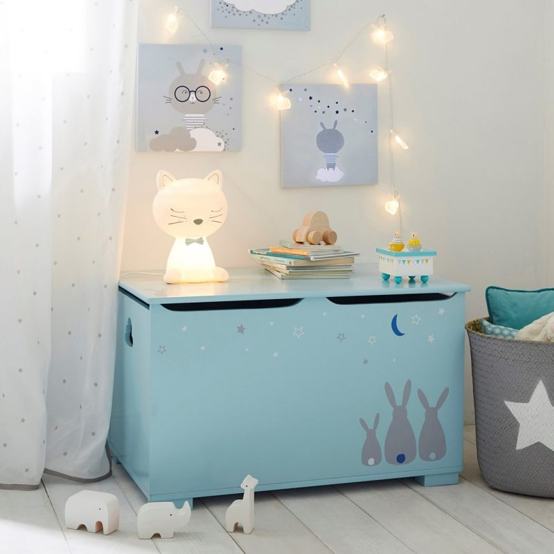 Blue painted toy chest with bunny decals
