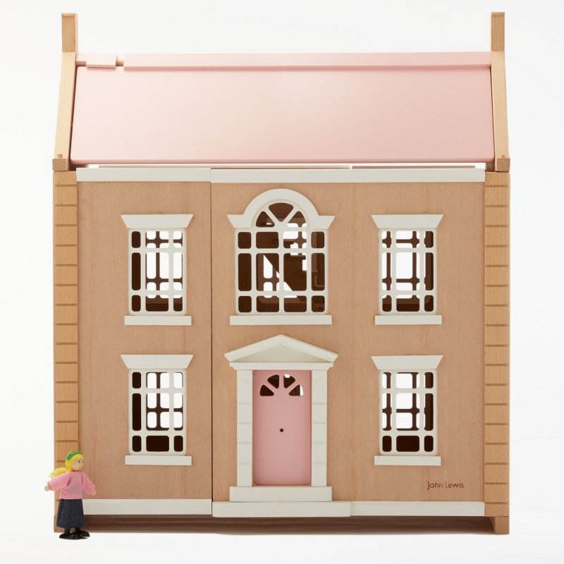 Wooden dolls house with pink roof and door
