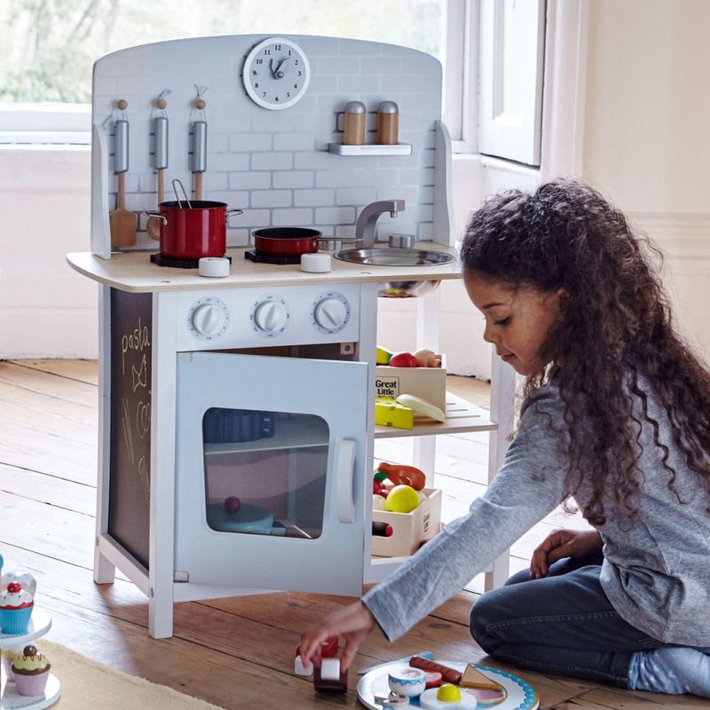 Compact wooden play kitchen in white