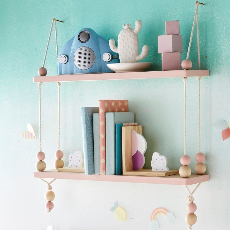 Pair of pink, rope suspended wall shelves