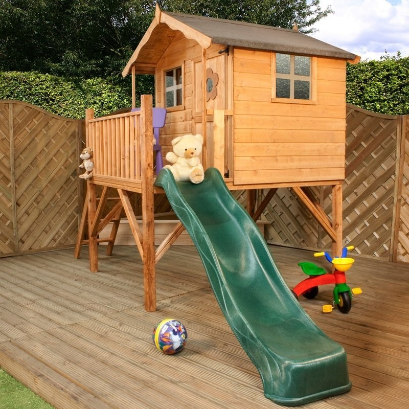 Elevated playhouse with a slide
