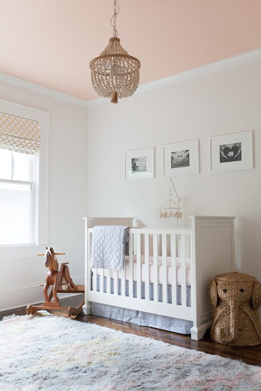 Nursery with blush pink ceiling
