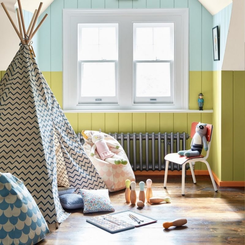 Bold green and orange paint colours in a children's playroom