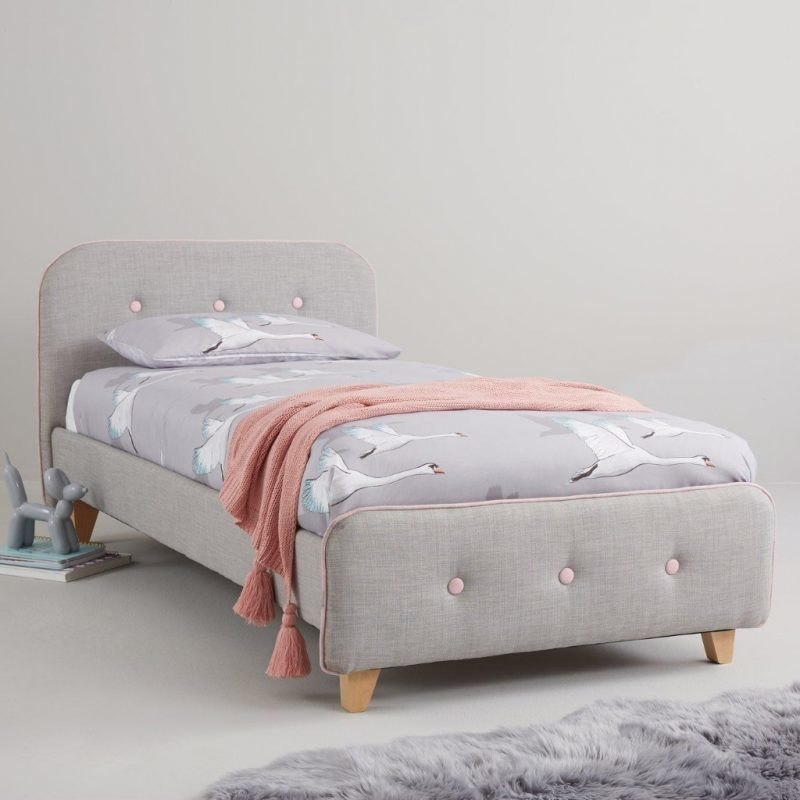 Grey and pink fabric upholstered bed