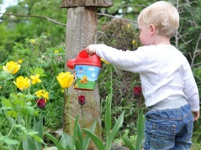 Child watering th eplants