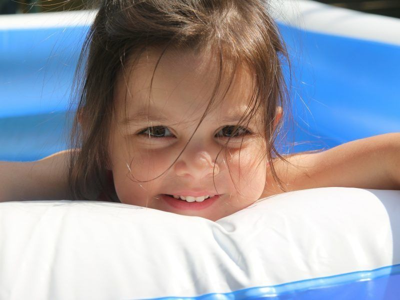 Child in paddling pool