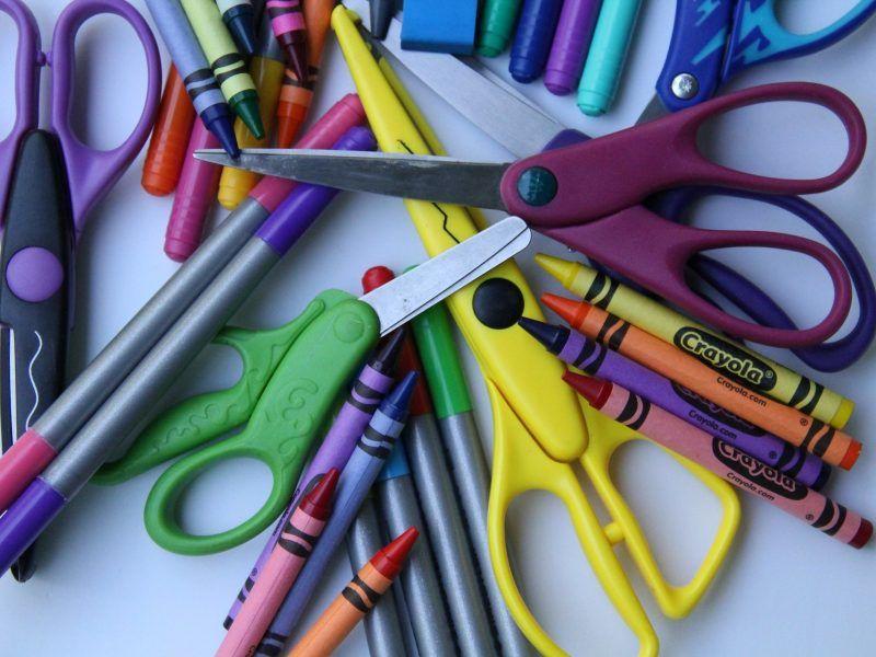 Assorted crayons, pencils, scissors, etc