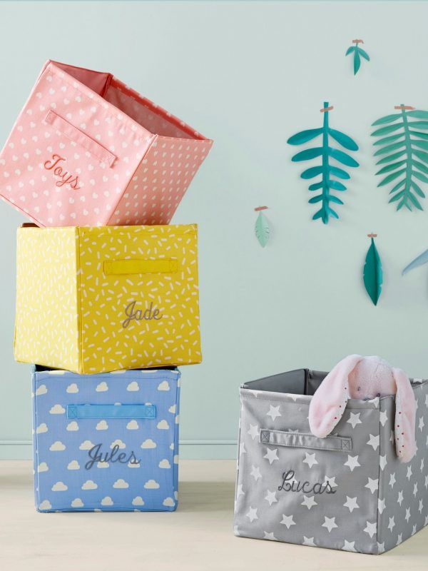 Pink, yellow, blue and grey fabric storage boxes