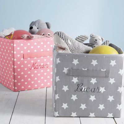 Grey and pink coloured storage boxes