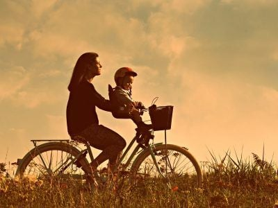 Mum riding a bike with child