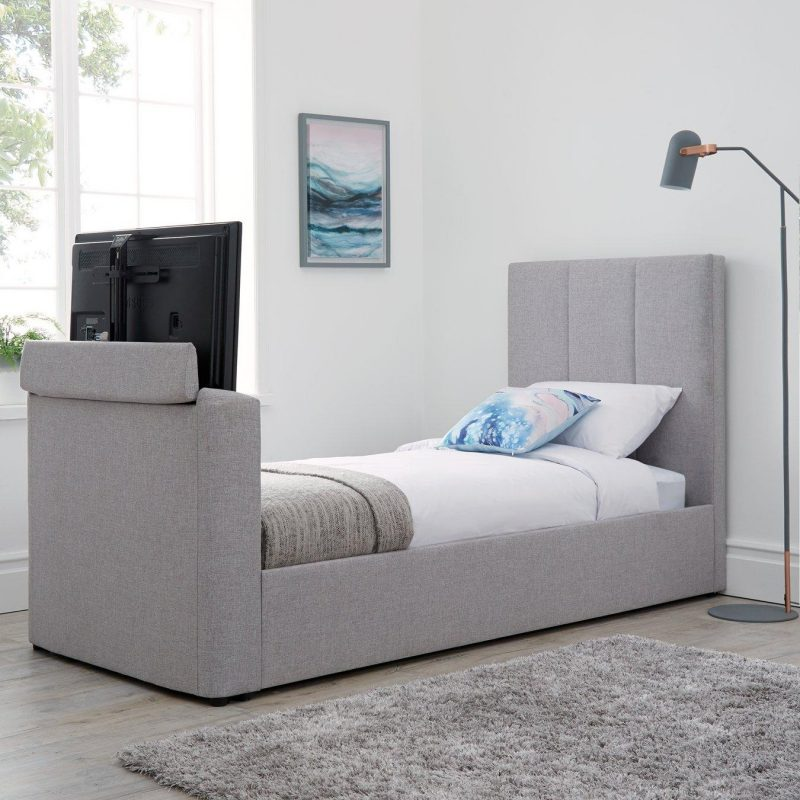 Single grey upholstered bed with TV console