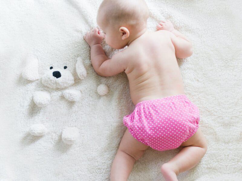 Baby wearing pink pants