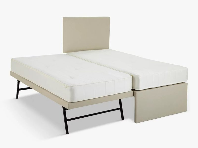 Upholstered single bed with a guest bed at the side