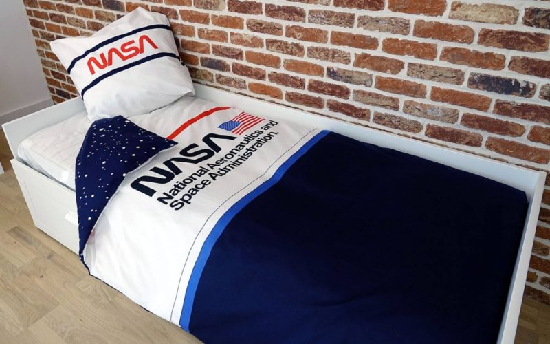 Navy and white bedding set with NASA logo