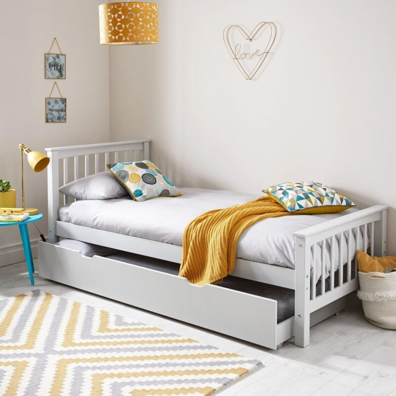White-painted single bed with slatted headboard