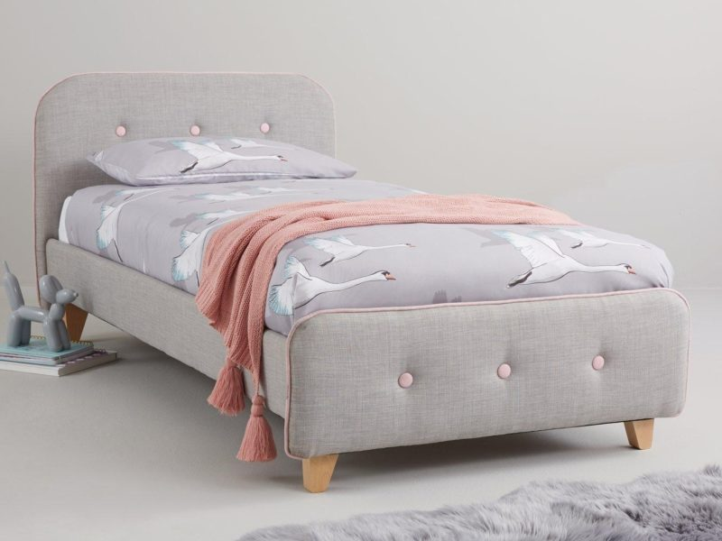 Grey fabric upholstered bed with pink trim