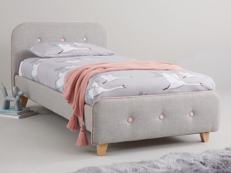 Grey fabric upholstered bed with pink detailing