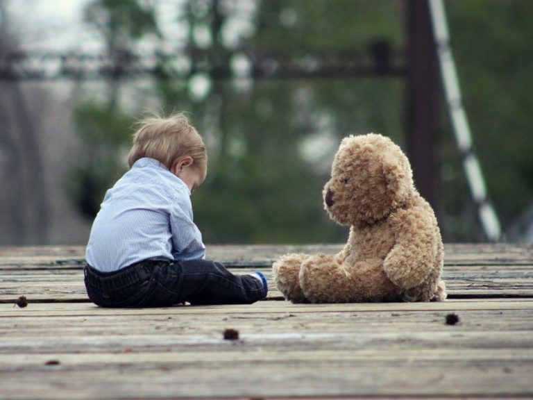 Young boy and teddy bear