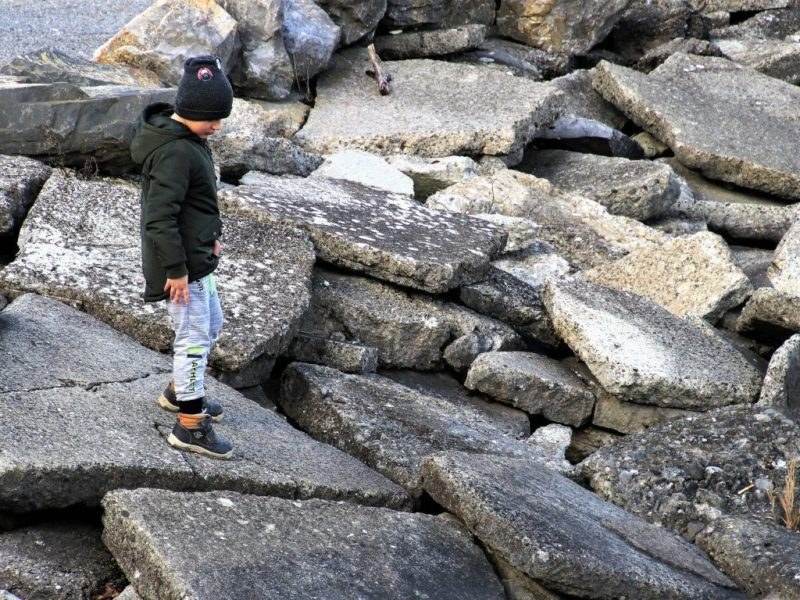 Child walking on rocks