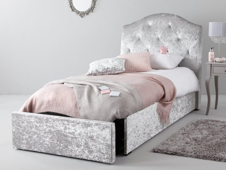 Grey velvet upholstered bed