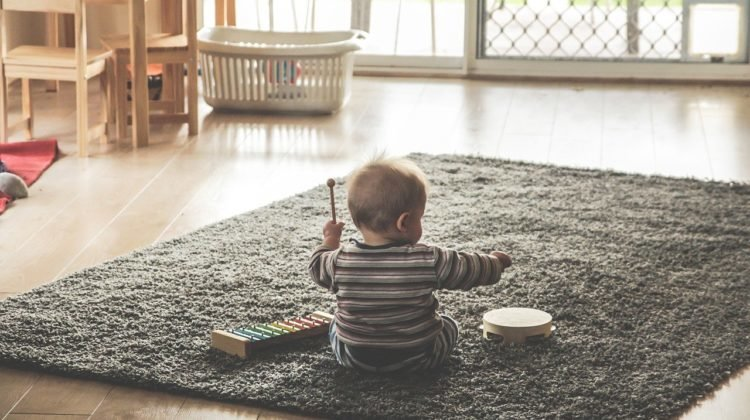 Young child happily playing alone