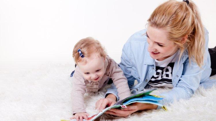 Mum reading to her child