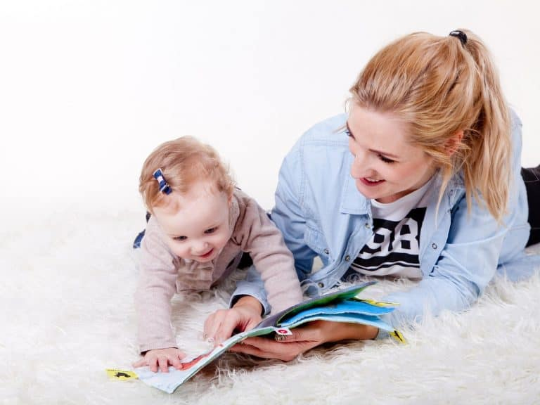 Mum reading to her child