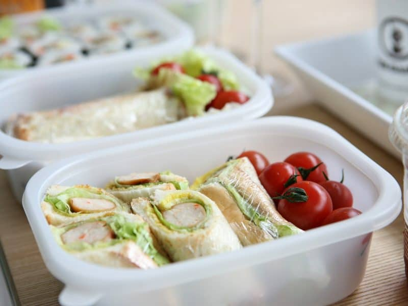 Lunch box with wraps and tomatoes