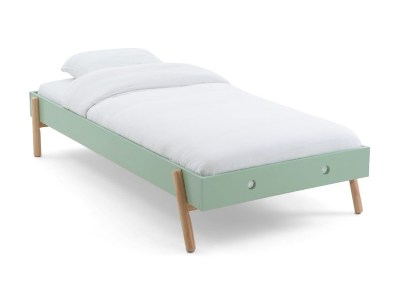 Green-painted children's bed
