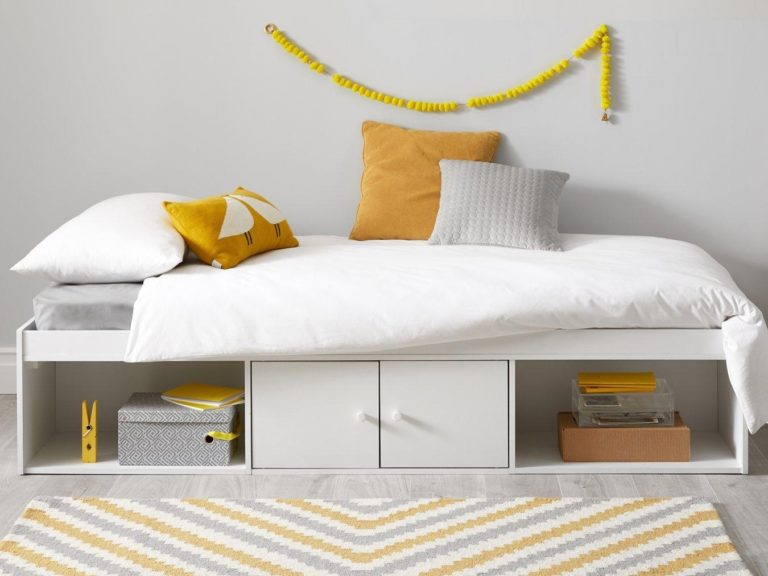 Cabin bed with open shelving and cupboard