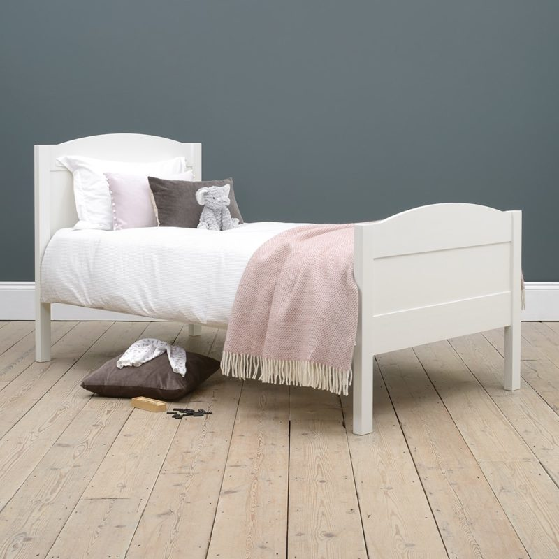 White-painted single bed with curved head and foot board