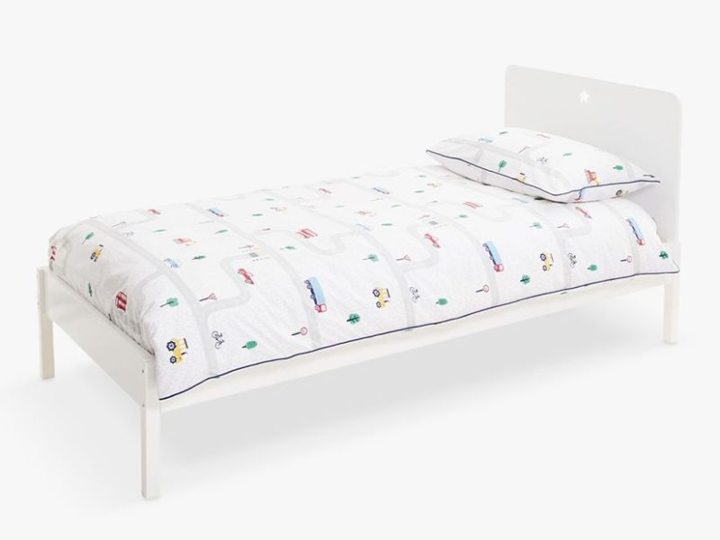 Single white-painted bed with star cut-out