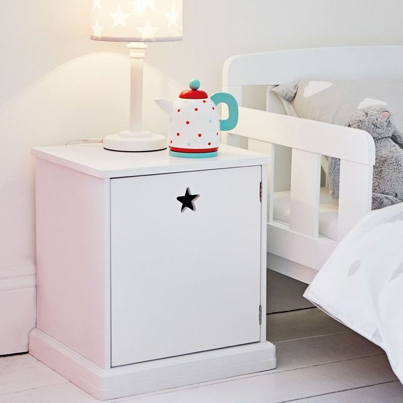 White bedside unit with star cut-out door