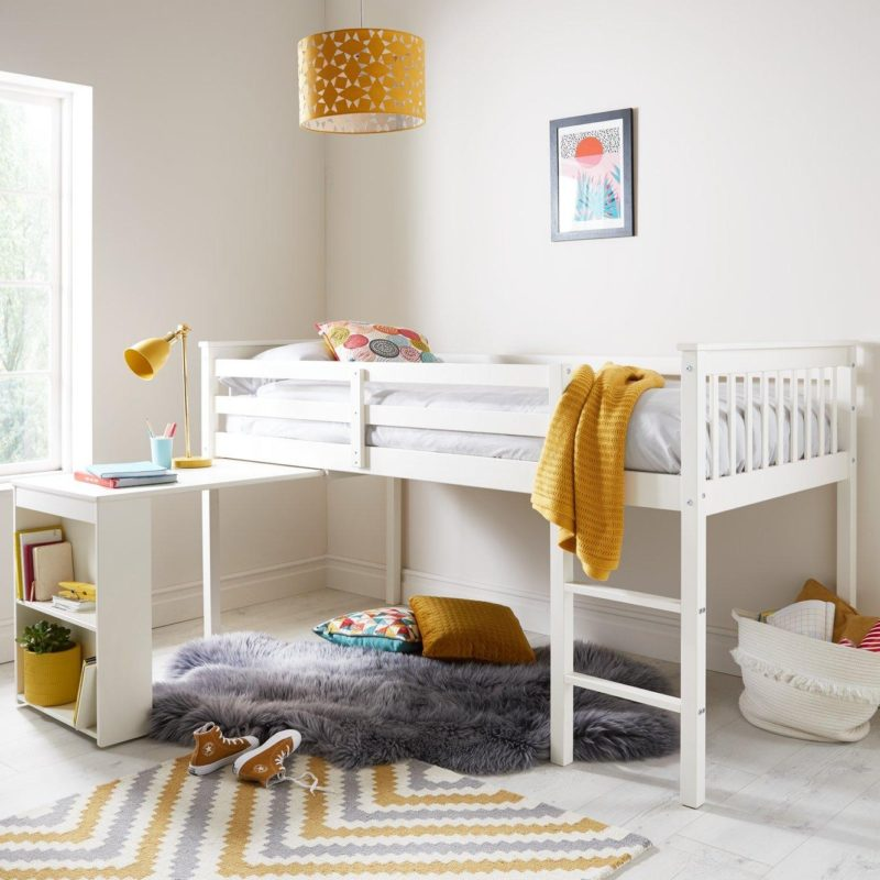 Kid's white-painted mis sleeper bed with a desk underneath