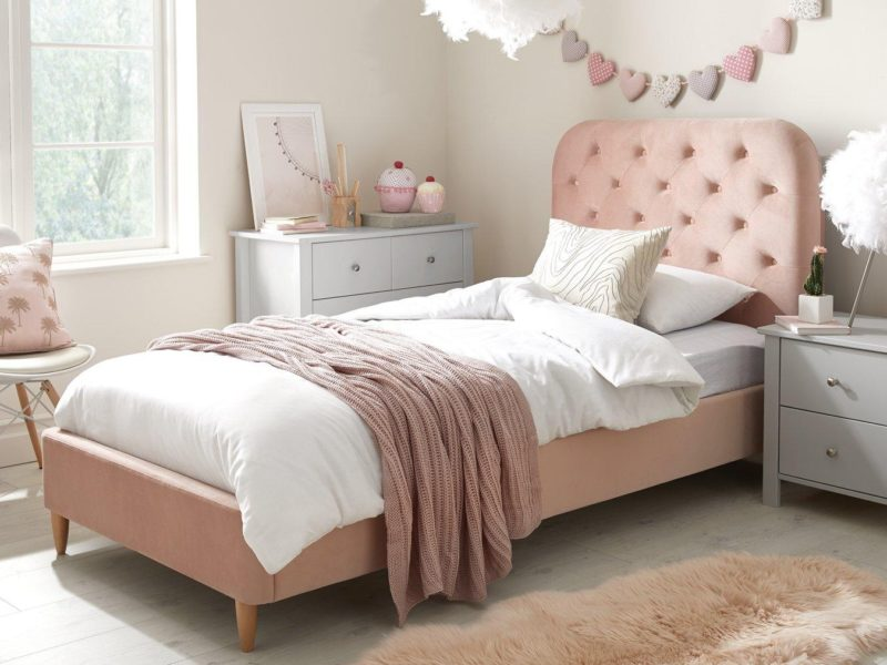 Pink velvet upholstered bed