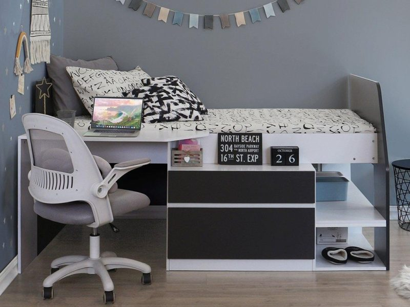 Black and white cabin bed with desk and storage