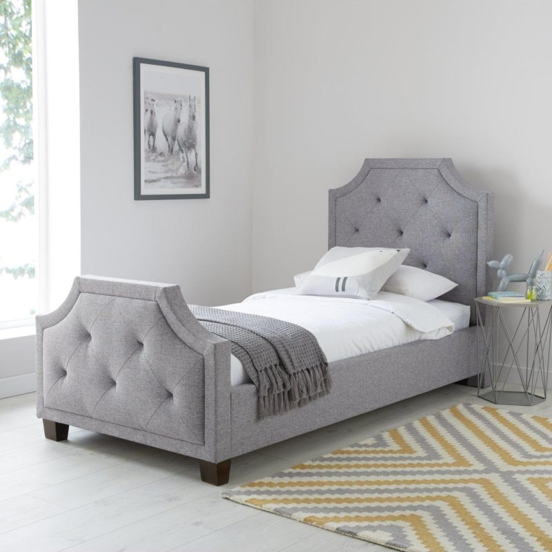 Grey fabric upholstered single bed